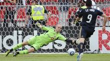 Toronto FC goalkeeper Stefan Frei lets in a goal scored Philadelphia Union Justin Mapp (not pictured) as Sebastien Le Toux runs to the net during the first half of their MLS game in Toronto, May 28, 2011. (© Mark Blinch / Reuters/REUTERS)