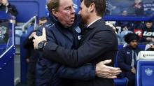 Queens Park Rangers manager Harry Redknap, left, greets Tottenham Hotspur's manager Andre Villas-Boas before their English Premier League soccer match at Loftus Road in London on Saturday. (EDDIE KEOGH/REUTERS)