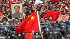 Violent clashes between protesters and riot police continued on Sunday in southern China, sparked by a dispute between China and Japan over a series of tiny islands between the two countries.