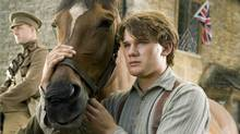 """Albert (Jeremy Irvine) and his horse Joey are featured in this scene from DreamWorks Pictures' """"War Horse."""" (Andrew Cooper / Dreamworks)"""