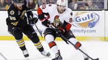 Ottawa Senators' Cory Conacher (89) tries to shoot in front of Boston Bruins' Johnny Boychuk (55) in the first period of an NHL hockey game in Boston, Friday, Dec. 27, 2013. (MICHAEL DWYER/AP)