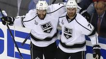 Los Angeles Kings Jeff Carter celebrates his goal against the New York Rangers with teammate Dwight King during the first period in Game 3 of their NHL Stanley Cup Finals hockey series in New York June 9, 2014. (SHANNON STAPLETON/REUTERS)