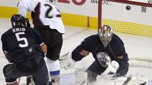 Edmonton Oilers defenceman Tomas Smid, seen chasing down Colorado Avalanche forward Milan Hejduk in front of goaltender Nikolai Khabibulin on Tuesday night, returned to the team after being sidelined with H1N1. (DAN RIEDLHUBER/Dan Riedlhuber/Reuters)