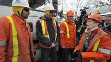 Hydro One President and CEO, Carm Marcello (third from left), and Premier Kathleen Wynne (right), speak with Hydro One crews from eastern Ontario at a work site in Scarborough, Friday, December 27, 2013. Hydro One forestry and line maintainer crews have come to Toronto to restore power to customers affected by last weekend's ice storm. The Canadian Press Images PHOTO/Hydro One Inc. (J.P. MOCZULSKI/THE CANADIAN PRESS IMAGES)