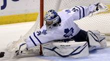Toronto Maple Leafs' James Reimer makes a save against the Florida Panthers during the third period of their NHL hockey game in Sunrise, Florida April 25, 2013. (Reuters)