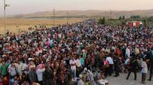 UN officials are concerned about more refugees fleeing into Iraq, fearing a shortage of aid supplies. So far, about 30,000 have crossed the border in five days. (the associated press)