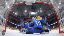 Sweden's Patric Hornqvist (R) tries to score past Italy's goalkeeper Daniel Bellissimo during their 2012 IIHF men's ice hockey World Championship game in Stockholm May 12, 2012. REUTERS/Joel /Pool (Joel Marklund/Reuters/Joel Marklund/Reuters)