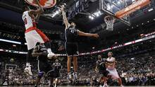 Toronto Raptors DeMar DeRozan (L) puts up a shot over Brooklyn Nets Kris Humphries (C) during the first half of their NBA game in Toronto, December 12, 2012. (MARK BLINCH/REUTERS)
