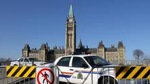 An RCMP cruiser sits by the gates of Parliament Hill in Ottawa, Nov. 17, 2012. (Lars Hagberg/The Canadian Press)