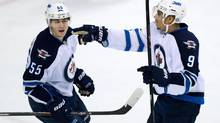 Winnipeg Jets' Evander Kane, right, and Mark Scheifele celebrate Kane's goal against the Vancouver Canucks during second period NHL hockey action in Vancouver, B.C., on Sunday December 22, 2013.Dyck (DARRYL DYCK/THE CANADIAN PRESS)