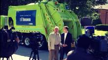 In this image taken from Doug Holyday's Twitter account, Holyday and provincial PC leader Tim Hudak stand in front of a city-contracted GFL garbage truck during a provincial by-election campaign photo-op on Wednesday, July 25, 2013. (Holyday campaign twitter account)