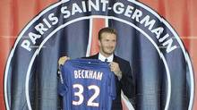 Soccer player David Beckham presents his new jersey at Paris St-Germain after a news conference in Paris January 31, 2013. (Reuters)