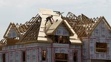 A builder works on the the roof of a new home under construction in the Montreal suburb of Brossard August 10, 2010. (© Shaun Best / Reuters/Shaun Best / Reuters)