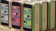 Apple iPhone 5c phones are pictured at the Apple retail store on Fifth Avenue in Manhattan, New York September 20, 2013. Apple Inc's newest smartphone models hit stores on Friday in many countries across the world, including Australia and China. (ADREES LATIF/REUTERS)