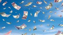 Paper money falling from the sky. (alfabravoalfaromeo/thinkstock)