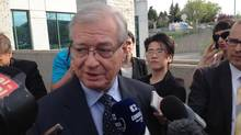 Former Laval mayor Gilles Vaillancourt scrums with reporters outside a courtroom in Laval, Que. on Thursday May 9, 2013. The ex-mayor faces one of the Criminal Code's most serious charges: directing a criminal organization. (Andy Blatchford/THE CANADIAN PRESS)