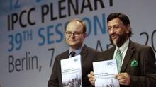 Ottmar Edenhofer, Co-Chairman of the IPCC Working Group III, and Rejendra K. Pachauri, Chairman of the IPCC, from left, pose prior to a press conference as part of a meeting of the Intergovernmental Panel on Climate Change (IPCC) in Berlin on April 13. (Michael Sohn/AP)