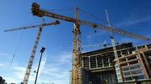 Cranes stand at a condominium construction site in Vancouver on Aug. 7, 2013. (Ben Nelms/Bloomberg)