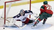 Columbus Blue Jackets goalie Sergei Bobrovsky, left, of Russia, stops a shootout attempt by Minnesota Wild's Matt Moulson in an NHL hockey game, Saturday, March 15, 2014, in St. Paul, Minn. (Jim Mone/AP)