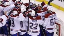 Montreal Canadiens goalie Carey Price is congratulated by teammates after the Canadiens' 3-1 win (AP Photo)