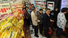 Chinese shoppers queue to buy discounted eggs at a supermarket in Hefei, in eastern China's Anhui province, on May 10, 2011. (STR/AFP/GETTY IMAGES)