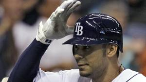 Tampa Bay Rays' Carlos Pena reacts as he crosses home plate after hitting a fifth-inning home run off Toronto Blue Jays pitcher Shawn Camp during a baseball game Wednesday, June 9, 2010, in St. Petersburg, Fla. (AP Photo/Chris O'Meara)