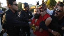 Police officers arrest a protester in Ciudad Juarez November 1, 2011. (Jose Luuis Gonzalez/REUTERS)