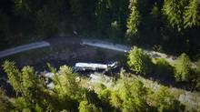 A tanker carrying 35,000 litres of jet fuel is shown after crashed Friday into Lemon Creek, about 60 kilometres north of Castlegar, B.C., on July 27, 2013. Some B.C. residents hope to have a class action lawsuit certified over the spill of 35,000 litres of jet fuel last month in southeast British Columbia. (Benjamin Jordan/THE CANADIAN PRESS)
