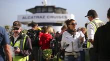 Tourists who had hoped to take a boat tour to Alcatraz Island, which is run by the National Park Service, line up for refunds after learning that the tour is closed because of the government shutdown, on Pier 33 in San Francisco, Oct. 1, 2013. (JIM WILSON/NYT)