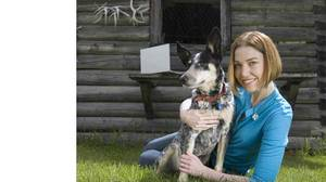 Freelance writer Kerry Taylor with her dog Pivo at her country home in Vernon, B.C. on May 25, 2010.