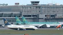 A Ryanair jet passes two Aer Lingus jets at Dublin Airport, Thursday October 5, 2006. (JOHN COGILL/AP)
