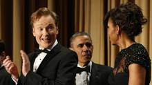 Comedian Conan O'Brien, left, looks toward First Lady Michelle Obama as U.S. President Barack Obama arrives at theWhiteHouseCorrespondentsAssociation Dinner in Washington on April 27, 2013. (Kevin Lamarque/Reuters)