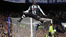 Newcastle United's Papiss Cisse celebrates his goal during the English Premier League match against Chelsea at Stamford Bridge, London, Wednesday. (Rebecca Naden/Associated Press)