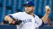 Toronto Blue Jays starting pitcher Mark Buehrle throws a pitch in the first inning in a game against the Tampa Bay Rays at Rogers Centre. (USA TODAY Sports)