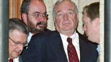 With finance minister Ralph Goodale, commnications director Mario Lague and policy advisor Scott Reid looking on, then-prime minister Paul Martin waits to address reporters after a cabinet meeting on Thursday, May 6, 2004. (JONATHAN HAYWARD)