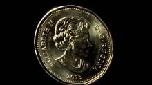 A Canadian dollar. (Johnathan Hayward/The Canadian Press)