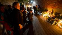 Cabbagetown neighbours of Nighisti Semret, who was stabbed to death on her way home from work Tuesday morning, gathered for a vigil October 25, 2012 in the alley where she was killed. (Galit Rodan/The Globe and Mail)