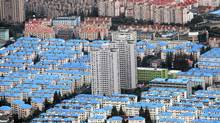 Chinese housing bubble fears grow (CARLOS BARRIA/REUTERS)