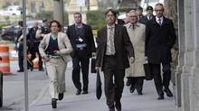 Parliamentary staff, including CSIS head Richard Fadden, second from right, leave the area after the shooting on Parliament Hill on Oct. 22, 2014. (Adrian Wyld/The Canadian Press)