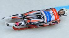 Alex Gough from Canada speeds down the course during her first run at the Women's luge World Cup race in Innsbruck Igls, Austria, on Saturday, Nov. 24, 2012. (Kerstin Joensson/AP)