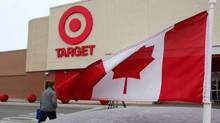 A Canadian flag flies on the car of a customer's car parked in front of a Target store in in Guelph, Ont. on March 5, 2013. (Dave Chidley/THE CANADIAN PRESS)