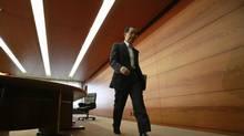 Bank of Japan governor Masaaki Shirakawa leaves a news conference in Tokyo on Thursday. (YURIKO NAKAO/REUTERS)
