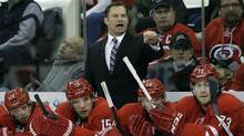 Carolina Hurricanes coach Kirk Muller directs his team during the first period of an NHL hockey game against the St. Louis Blues in Raleigh, N.C., in this Jan. 31, 2014, photo. The Hurricanes have fired Muller. The team announced his dismissal Monday, May 5, 2014. (Gerry Broome/AP)