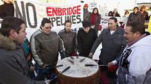 First-nations drummers take part in a rally outside an Edmonton hotel where a hearing is being held into the Enbridge Northern Gateway pipeline project. (JASON FRANSON/JASON FRANSON/THE CANADIAN PRESS)