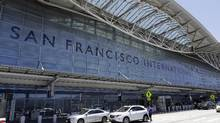 In this July 11, 2017 photo, vehicles wait outside the international terminal at the San Francisco International Airport, in San Francisco. (Marcio Jose Sanchez/AP)