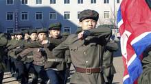 North Korean students attend a rally held to show their willingness to enlist in the army March 14, 2013 in this picture released by the North's official KCNA news agency in Pyongyang March 15, 2013. (KCNA/REUTERS)