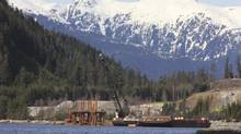 Cranes work in the water at the Kitimat LNG site near Kitimat, in northwestern British Columbia on April 13, 2014. (JULIE GORDON/REUTERS)