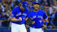 Jason Grilli #37 of the Toronto Blue Jays and Edwin Encarnacion #10 react after the third out in the eighth inning against the Baltimore Orioles during the American League Wild Card game at Rogers Centre on October 4, 2016 in Toronto, Canada. (Vaughn Ridley/Getty Images)