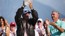 Scott Dunlap, wearing jacket, raising the Boeing Classic trophy (LINDSEY WASSON/AP/Seattle Times)