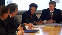 The Governor-General of Canada, Michaelle Jean, addresses Prime Minister Stephen Harper and other officials gathered for a briefing on the situation in Haiti at the department of Foreign Affairs in Ottawa on Jan. 13, 2010. (Pawel Dwulit/The Canadian Press)